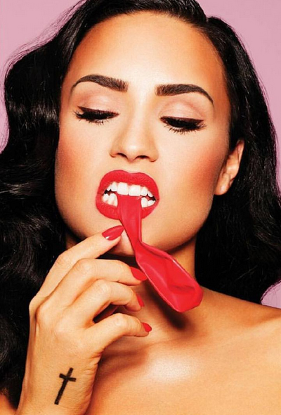 Demi Lovato got toothy with a red balloon.